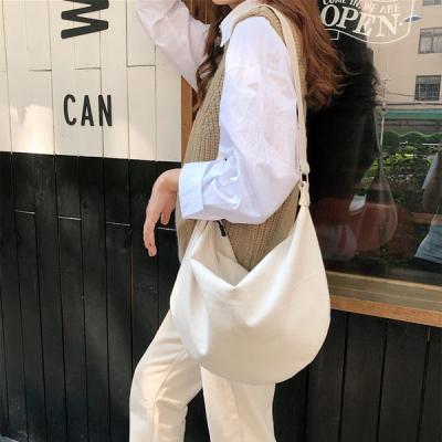리아슨 캔퍼스 반달 숄더 호보백 데일리백